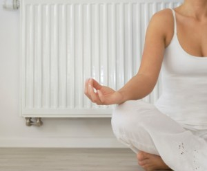 Woman-doing-yoga-in-front-of-furnace