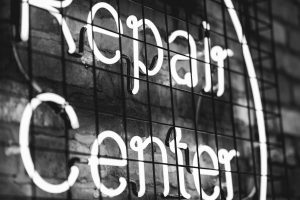 black-and-white-photo-of-neon-repair-center-sign