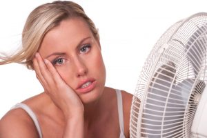 woman-cooling-off-in-front-of-fan