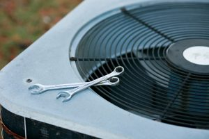 air-conditioner-with-wrench-placed-on-top